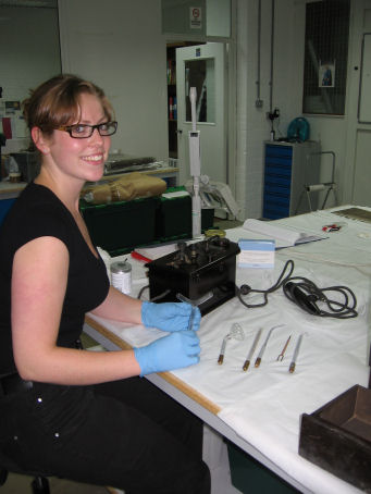 Lou in the Conservation Studio with the UV Ray Machine