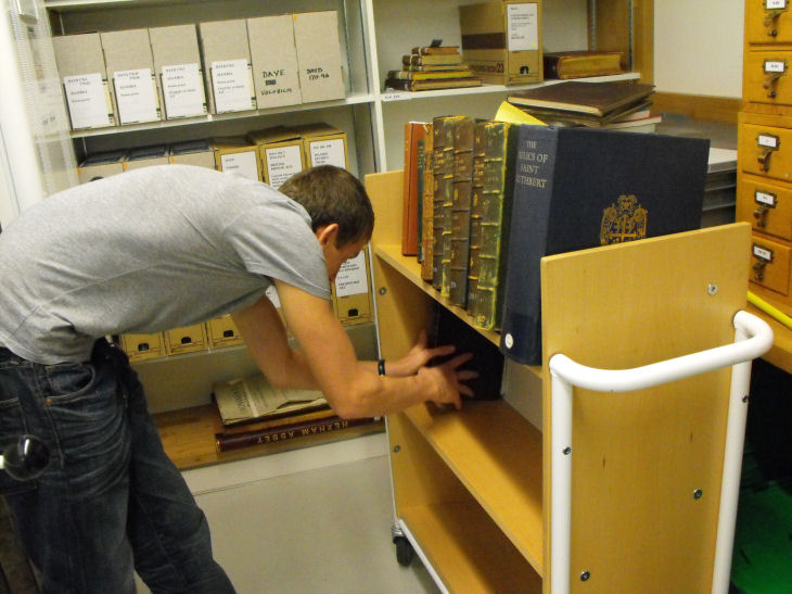 Volunteers help to reshelve library books