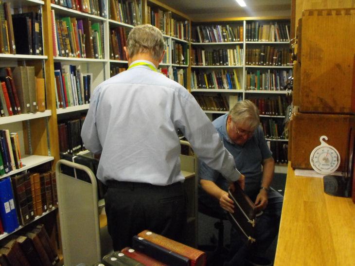 Volunteers help to reshelve library books