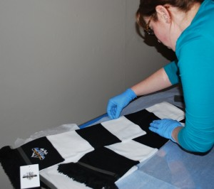 Louise preparing an NUFC scarf to go in a case