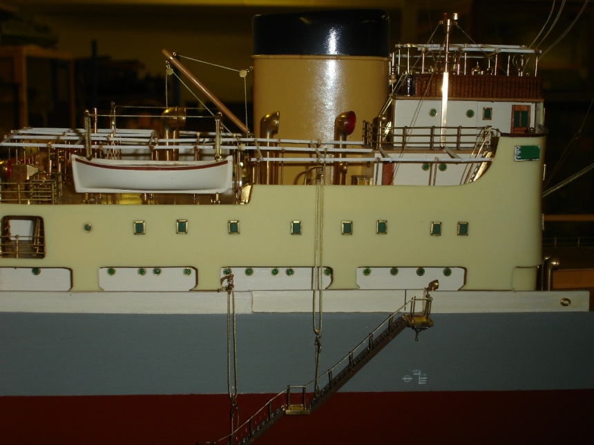 Side view: showing white Plimsoll Line underneath the walkway