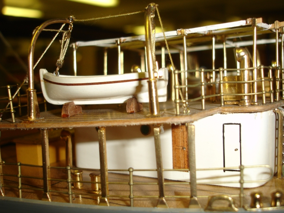 Close up: showing life boat and gold plating