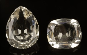 Image of two replica diamonds -  the pear-shaped Great Star of Africa, and the cushion-shaped Lesser Star of Africa