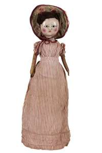 Wooden and leather doll.
