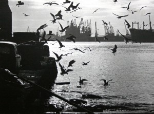 industrial scene of the River Tyne, with cranes and ships in dock, 1970s