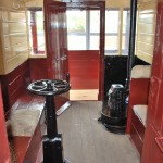 Another internal view of the brake van from the other end showing not only the brake handle left but also the guard's stove.