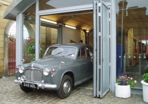 After checking its condition the car is pushed to the ramp through the folding doors that were designed into the building with this type of operation in mind.