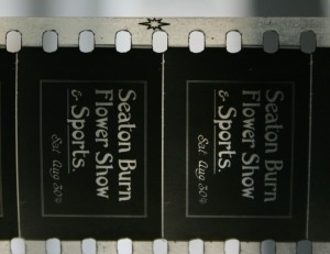 Seaton Burn Flower Show film title with nitrate film symbol