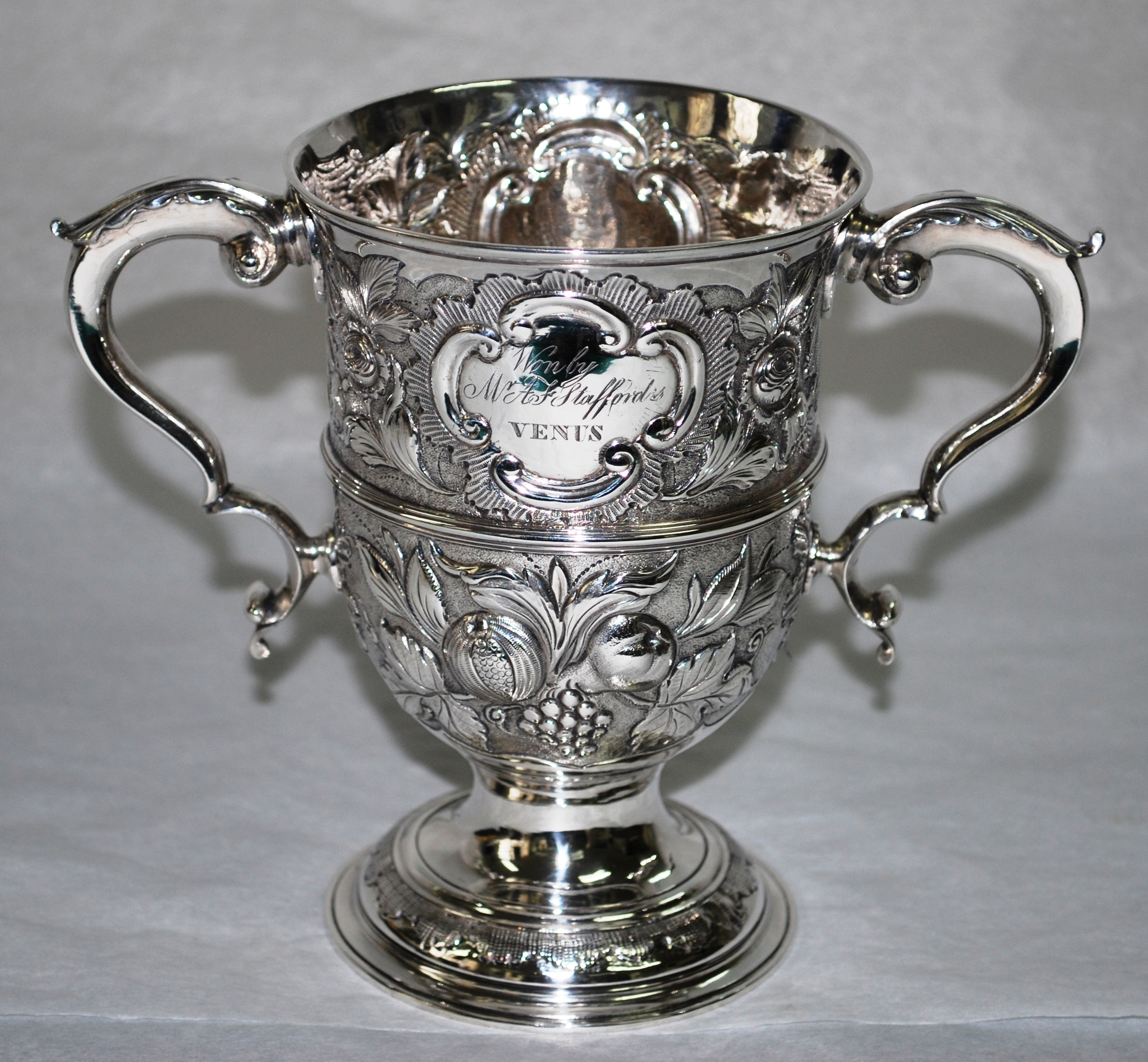 Silver cup engraved with the names of the winning boat, VENUS, and her owner, A F Stafford