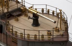 The forward 4 - inch gun with shells stored around the gun platform