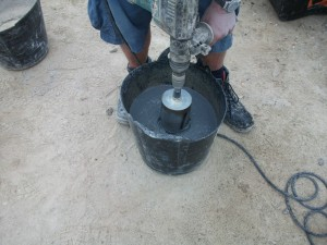 A diamond core drill being used to cut a cylinder of whinstone