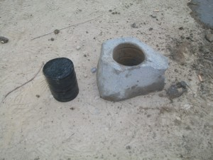 Whinstone cylinder and the rock from which it was cut