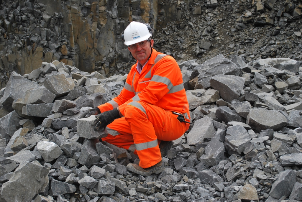 Quarry manager Peter Scott selecting pieces of whinstone