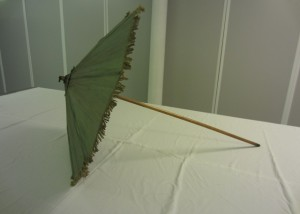 Walking stick parasol covered in green silk trimmed with a short silk fringe, 1770s – 1800s. TWCMS: J1383