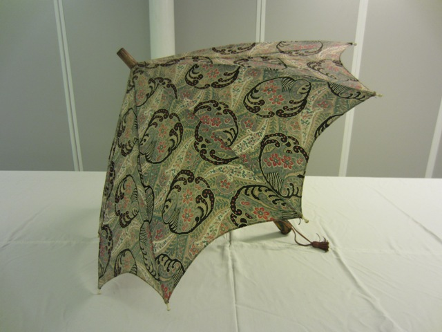 This parasol is the latest in the Collection, dating 1910-1925. It is labelled 'British Make'. TWCMS: J1387