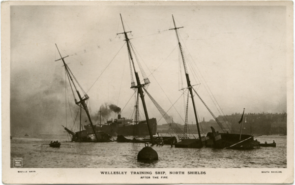 Postcard of Wellesley sunk at her moorings after the fire.