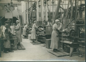 Wome workers operating milling machines.