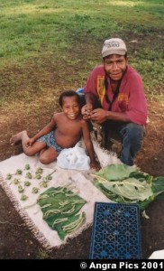 Man and child selling areca nuts and betel leaves and flowers. Photo by Austronesian Experiences. Licence: CC BY-NC-ND 2.0