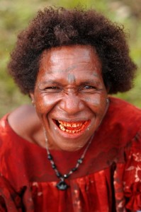 Woman with red stained teeth, PNG. Photo by Ian @ ThePaperBoy. Licence: CC BY 2.0