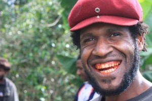 Young man with red teeth stained from betel nut chewing. Photo by counterculturecoffee. Licence: CC BY-NC-ND 2.0