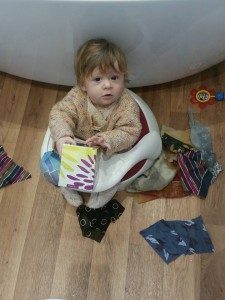 Xanthe playing with her fabric pull-box at home. Photo: Jenny Wade