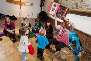 Claudia sharing the Exhibition Explorers Encyclopedia with the children - photo: Mark Savage