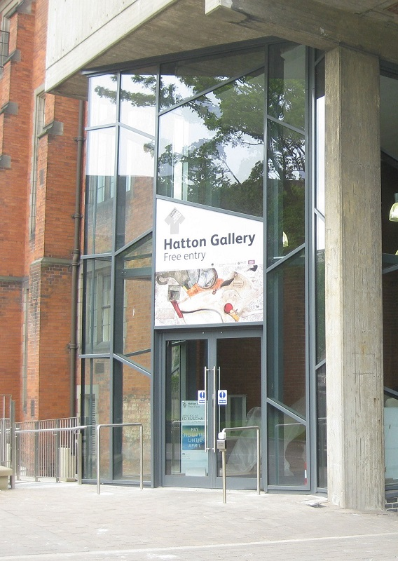 Glass-fronted entrance to building with 'Haton Gallery' sign