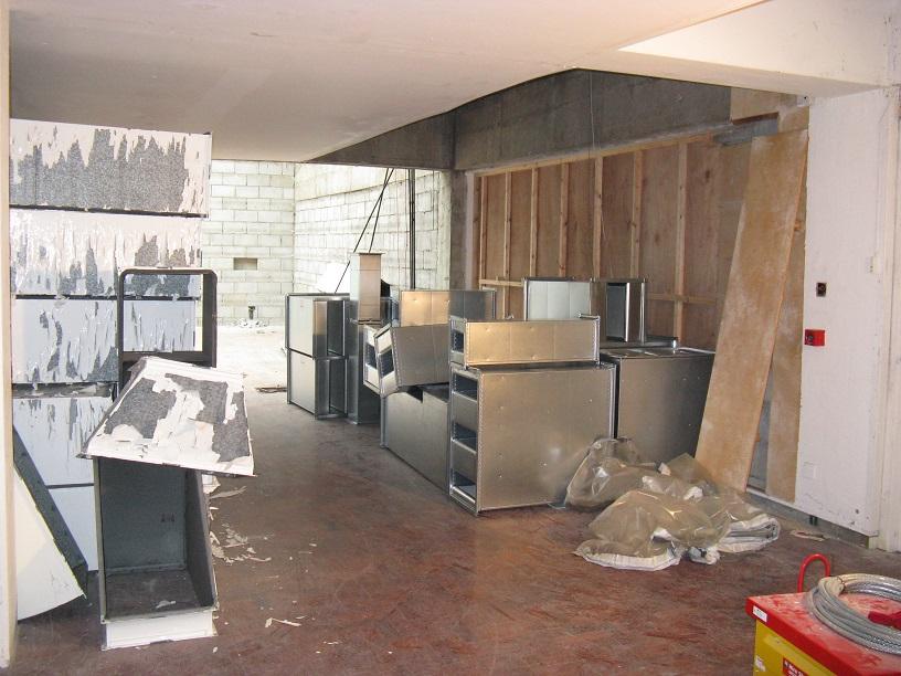 Part interior building site space with building debris - wooden floor
