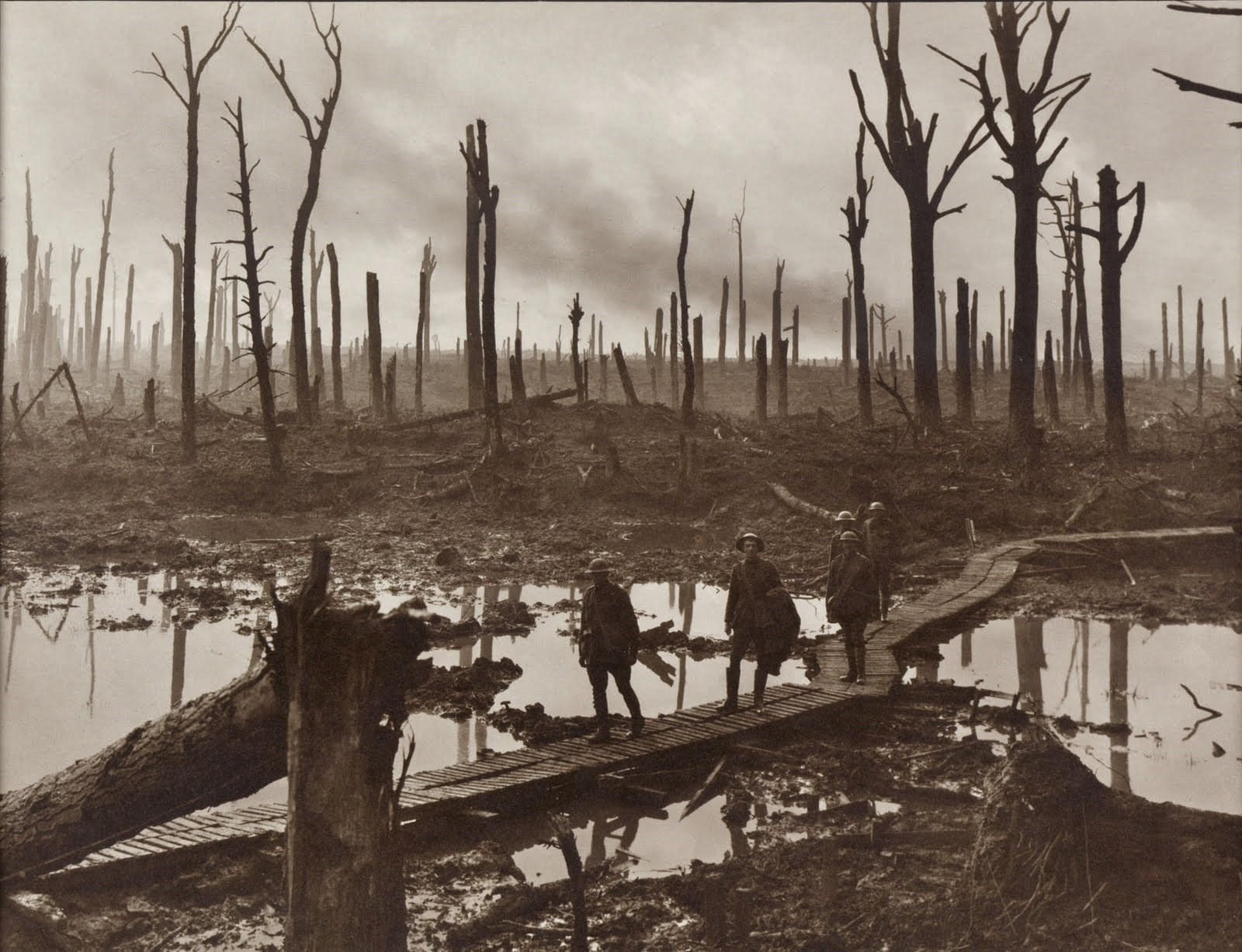 Australian gunners on a duckboard track in Château Wood near Hooge, 29 October 1917. Photo by Frank Hurley. Image: Collection Database of the Australian War Memorial, ID Number: E01220