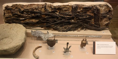 A selection of Carrawburgh finds are on display. These include a portion of the wattle and daub, made by a woven lattice of wooden strips being daubed with a sticky material (usually made of some combination of wet soil, clay, sand, animal dung and straw). Below is an iron shovel which would have been used by Lion-grade members to tend the sacred flame.