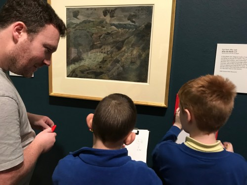 Children from Hotspur Primary School working on their spidergrams in the gallery