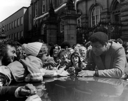 Muhammad Ali greets a young fan outside South Shields Town Hall on Saturday 16 July 1977